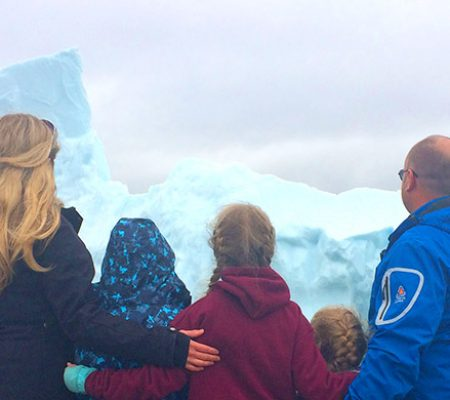 A family looking at icebergs