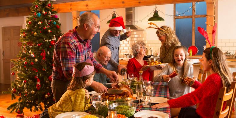 A family finishing their Christmas dinner