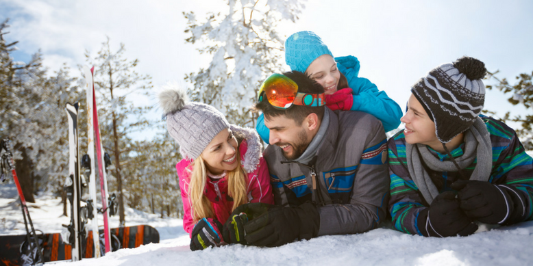 A family having fun on a ski hill