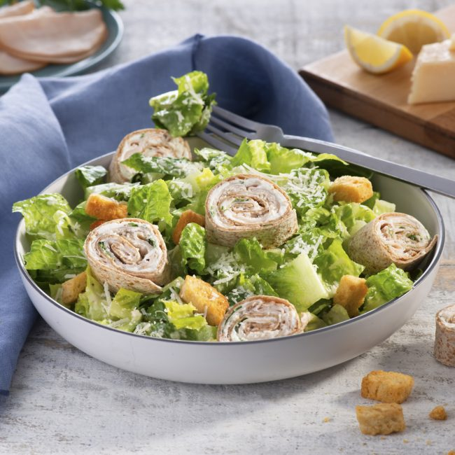 Pinwheel Wraps Over Caesar Salad