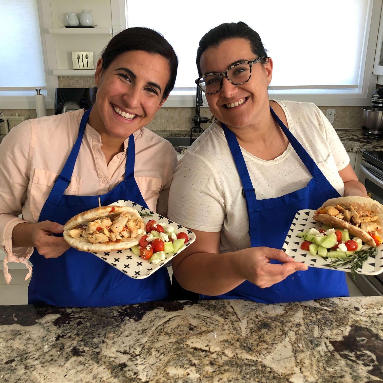 The GG Sisters in their kitchen cooking One Pan Chicken Souvlaki